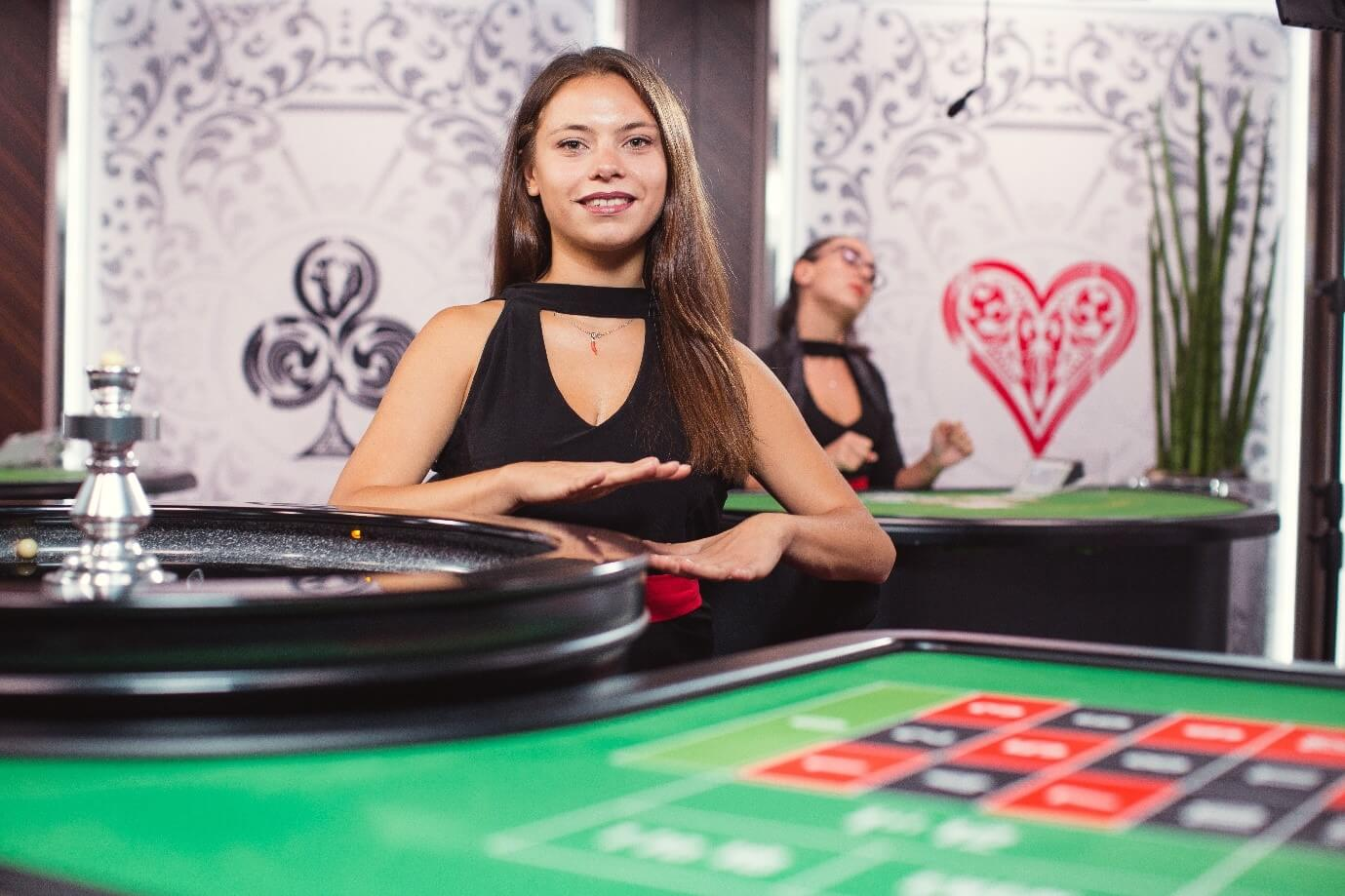 Croupier indicates no more bets at Evolution Gaming live roulette casino table