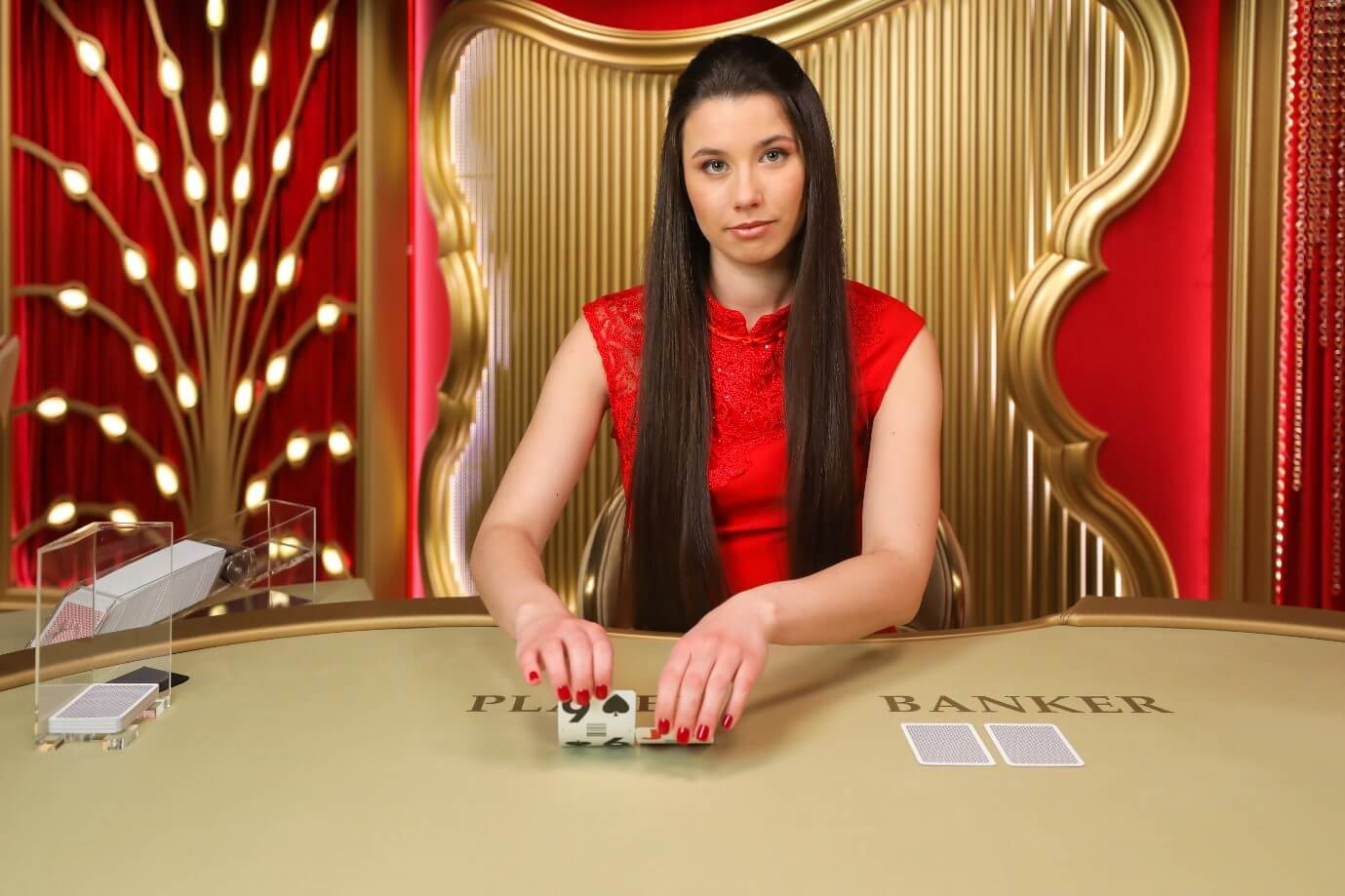 An Evolution Gaming dealer squeezing cards at a Live Baccarat table